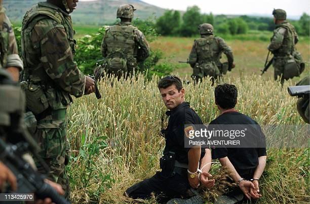 American Soldiers Disarm KLA Militants Leaving the Town of Zegra On June 16th 1999