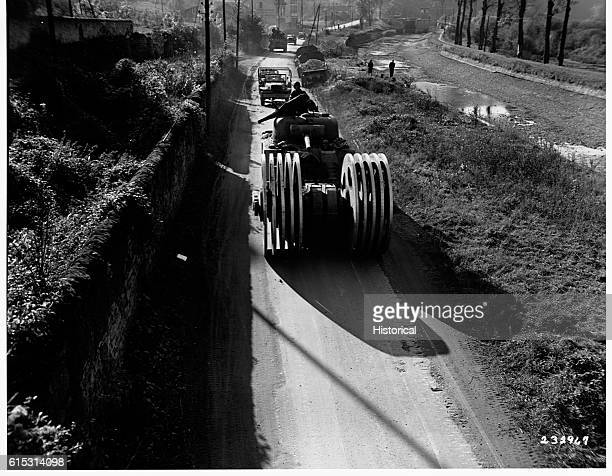 American soldiers drive an M4 tank outfitted with a mine detonator down a road in Liverdun France The detonator weighs 30 tons and the tank and...