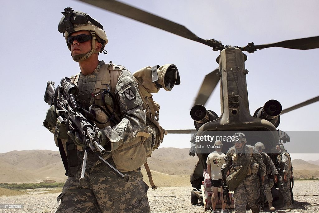 American soldiers from the 10th Mountain Division arrive as part of Operation Mountain Thrust to a U.S. base near the village of Deh Afghan on June 22, 2006 in the Zabul province of Afghanistan. The US military announced today that four American soldiers were killed in fighting after coalition forces attacked enemy extremists in north-eastern Afghanistan. The anti-Taliban operation, mainly by American, British and Canadian forces, entered it's second week across a vast area in southern Afghanistan.