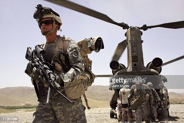 American soldiers from the 10th Mountain Division arrive as part of Operation Mountain Thrust to a US base near the village of Deh Afghan on June 22...