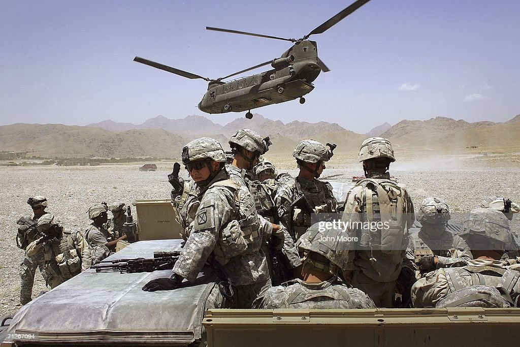 American soldiers from the 10th Mountain Division deploy to fight Taliban fighters as part of Operation Mountain Thrust to a U.S. base near the village of Deh Afghan on June 22, 2006 in the Zabul province of Afghanistan. The US military announced today that four American soldiers were killed in fighting after coalition forces attacked enemy extremists in north-eastern Afghanistan. The anti-Taliban operation, mainly by American, British and Canadian forces, entered it's second week across a vast area in southern Afghanistan.