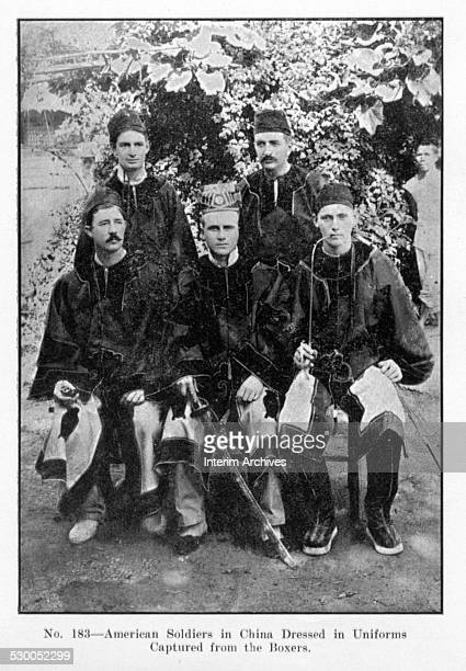 American soldiers in China dressed in uniforms captured from the Boxers late nineteenth century From the photo book 'Scenes in the Philippines Cuba...