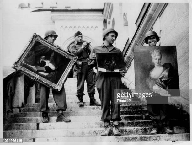 American soldiers in Germany recover and document stolen paintings after the collapse of the Nazi regime 1945.