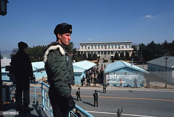 American soldiers in Panmunjom on the 38th parallel in the DMZ or demilitarised zone This 25 mile wide 156 mile long no man's land separates North...