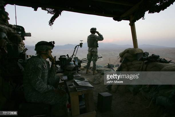American soldiers look into Pakistan from an US outpost October 15 2006 near Camp Tillman Afghanistan just two kilometers from the Pakistan border...