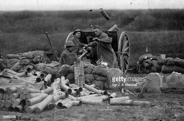 American soldiers of Battery C 6th Field Artillery firing their field gun surrounded by empty shell cases on the Lorraine front Beaumont France