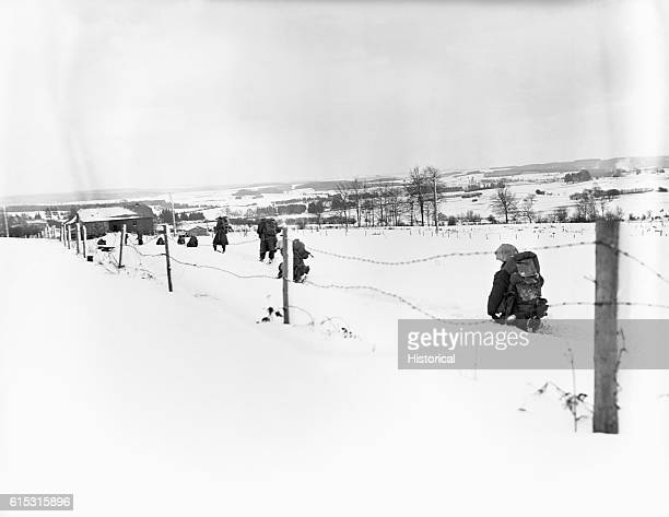 American soldiers of the 30th Infantry Division slog through waistdeep snow towards SartLezSt Vity during the Battle of the Bulge Belgium January...