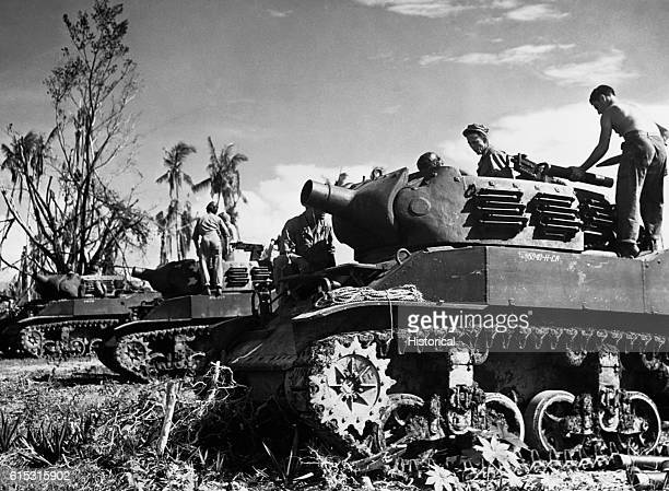 American soldiers operate tanks against Japanese positions on Biak Island. New Guinea, July 12, 1944