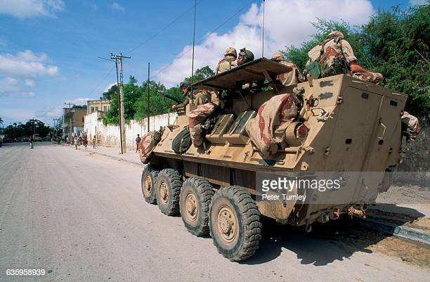 American soldiers patrol a street along the Green Line which was a heavily contested area during the civil war In the 1980s a civil war erupted in...