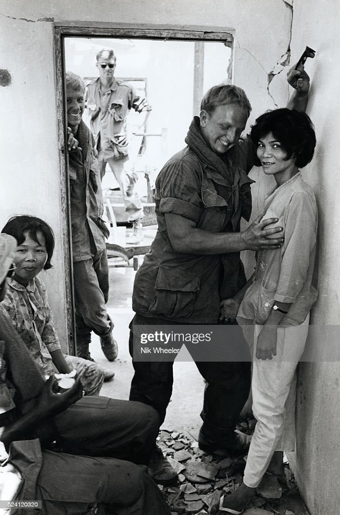 American Soldiers Play With Vietnamese Prostitutes In