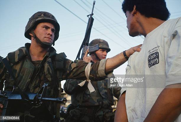 American soldiers put rebels under arrest as they have deployed in Panama to overthrow Manuel Antonio Noriega