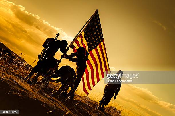 wwii american soldiers raise the usa flag - armistice day stock photos and pictures