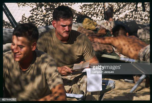 American soldiers relax with a card game while stationed in Saudi Arabia during Operation Desert Shield Iraqi president Saddam Hussein invaded Kuwait...