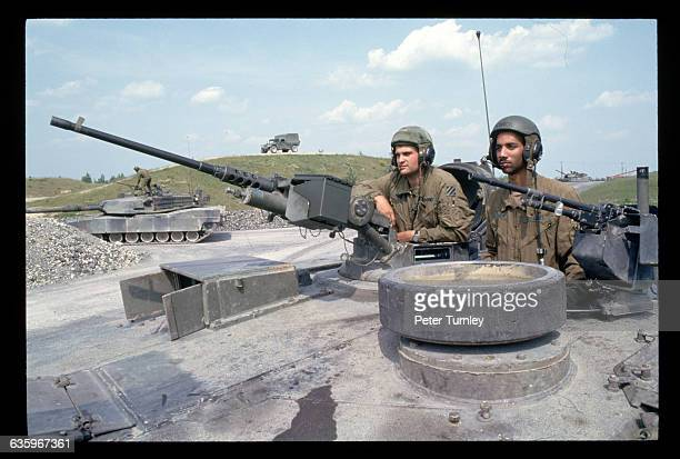 American soldiers train in an M1 tank in Grafenwohr Germany These Army troops may be deployed to the former Yugoslavia if the US intervenes there