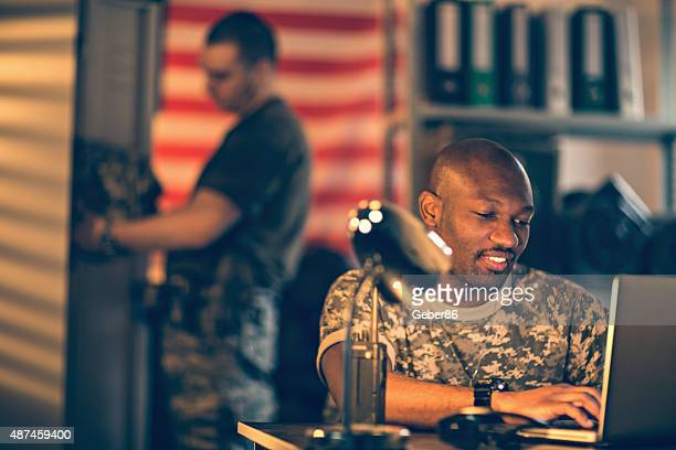 American soldiers using laptop