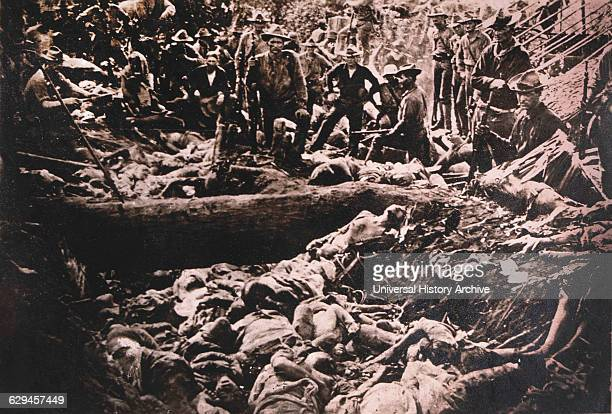American Soldiers View Bodies of Dead Philippine Insurgents, Philippines, circa 1900.