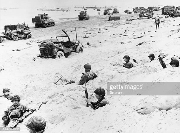 American soldiers wait in foxholes at Utah Beach on DDay for the order to move inland against German fortifications