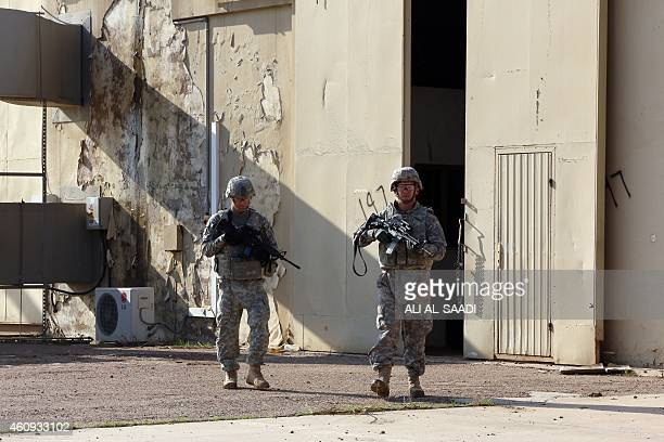 American soldiers walk around at the Taji base complex which hosts Iraqi and US troops and is located thirty kilometres north of the capital Baghdad...