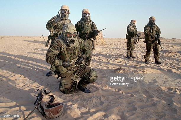 American soldiers wear gas masks during a chemical warfare exercise in Saudi Arabia. They are part of a U.S.-led coalition preparing to liberate...