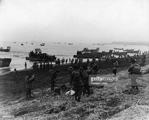American soldiers who are members of the Southern landing force arrive at Massacre Bay in Attu the Aleutian Islands Alaska May 11 1943 Landing boats...