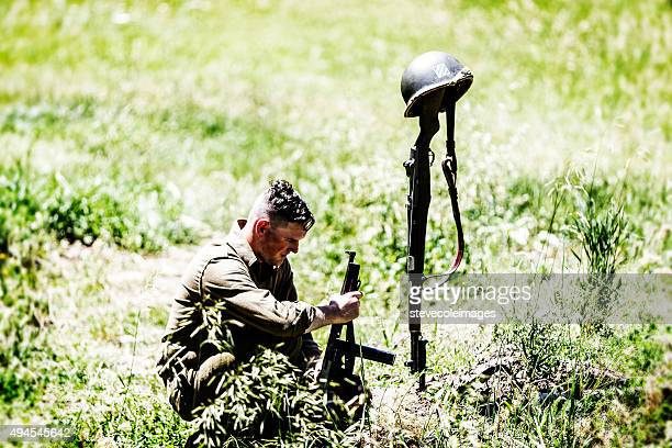 american solider and death - soldier praying stock photos and pictures