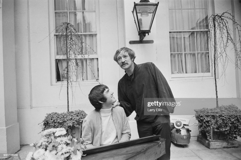 American songwriter, composer and singer Jimmy Webb, playing a piano with Irish actor and singer Richard Harris (1930 - 2002), UK, 16th October 1968.