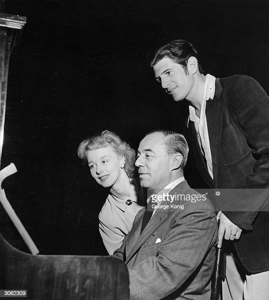 American songwriter Richard Rodgers with Iva Withers and Stephen Douglass two of the cast members of the production of 'Carousel' which is showing in...