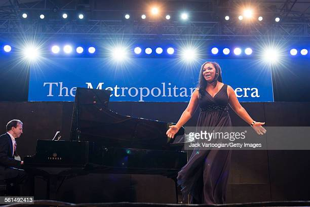 American soprano Janai Brugger performs an aria during the seventh annual, season-opening concert in the Metropolitan Opera Summer Recital Series at...