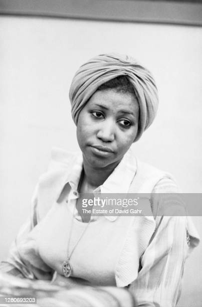 American soul and gospel singer songwriter, pianist, and civil rights activist Aretha Franklin performs at the piano during a recording session at...