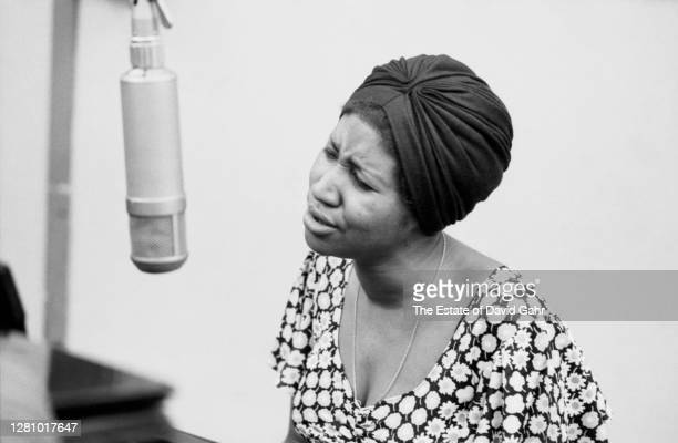 American soul and gospel singer songwriter, pianist, and civil rights activist Aretha Franklin sings and performs at the piano during a recording...