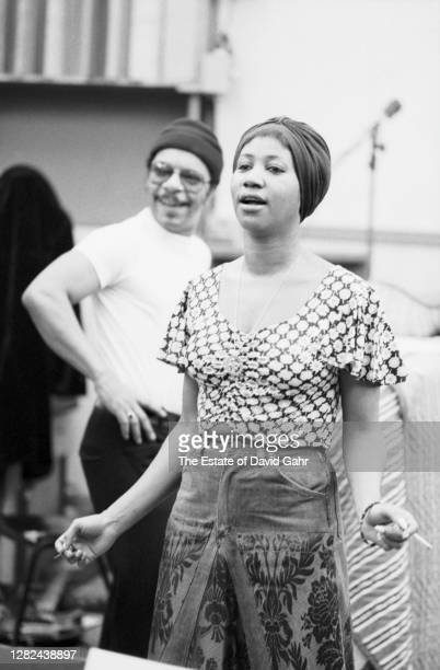 American soul and gospel singer songwriter, pianist, and civil rights activist Aretha Franklin dances to a playback, with drummer Grady Tate, during...