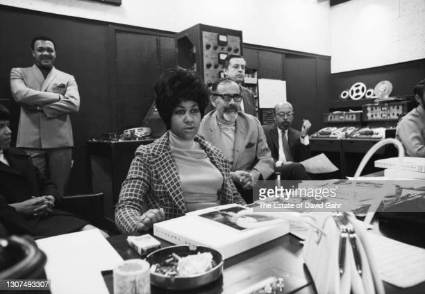 American soul and gospel singer songwriter, pianist, and civil rights activist Aretha Franklin poses for a portrait during a recording session at...
