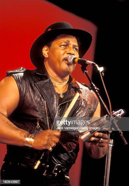American soul singer Aaron Neville plays a cowbell during a performance at a Benefit for and at Central Park SummerStage New York New York August 13...