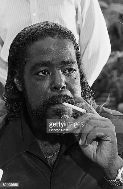 American soul singer and multiple Grammy Award winner Barry White smokes a cigarette during a 1988 Los Angeles California photo portrait session...