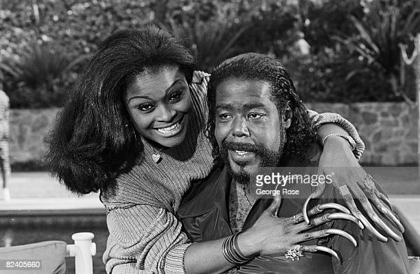 American soul singer and multiple Grammy Award winner Barry White poses with his second wife Glodean James during a 1988 Los Angeles California photo...