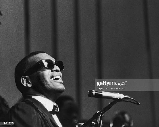 American soul singer and pianist Ray Charles sings on stage during his first British concert appearance at Finsbury Park London England May 13 1963