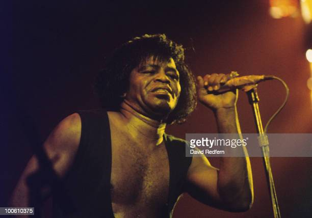 American singer James Brown performs on stage circa 1980