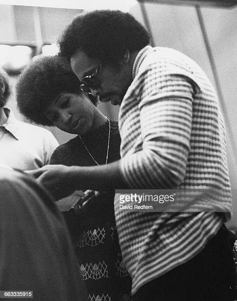 American singer Aretha Franklin in a recording studio with composer and record producer Quincy Jones circa 1973
