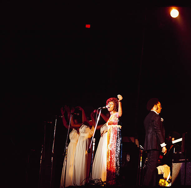 Singer Aretha Franklin performs on stage as part of...