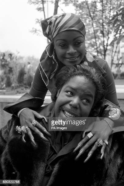 American soul singer Barry White gets an affectionate hug from his long fingernailed wife Glodean of the Love Unlimited singing group during a...