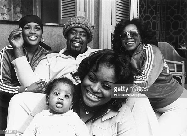 American soul singer Barry White smiles with his wife Goldean his baby daughter Shahara and his backup singers Linda James and Diana Taylor during a...