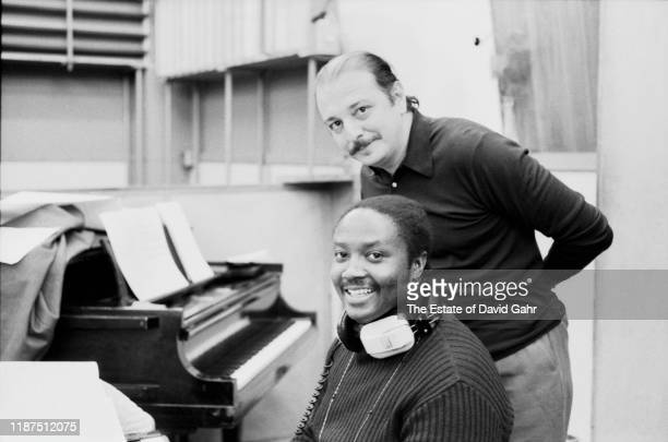 American soul singer keyboardist songwriter and arranger Donny Hathaway and producer Arif Mardin pose for a portrait at an Atlantic Records recording...