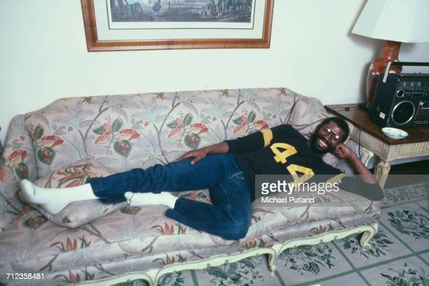American soul singer Teddy Pendergrass posed lying on a couch backstage in New York United States in April 1981