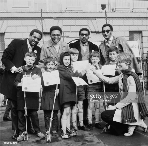 American soul vocal group Four Tops with schoolchildren from Hiterfield School London UK 16th March 1970