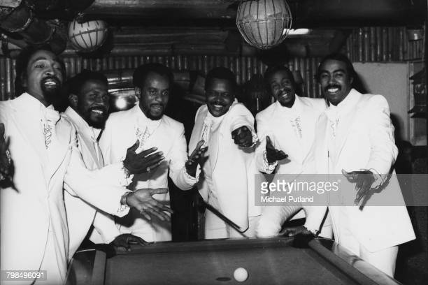 American soul vocal group The Tymes posed together around a pool table in February 1975 Members include Lafayette Gamble Donald Banks Albert Berry...