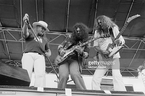 American southern rock group Lynyrd Skynyrd performing at John F Kennedy Stadium Philadelphia USA 11th June 1977 Left to right Ronnie Van Zant Gary...