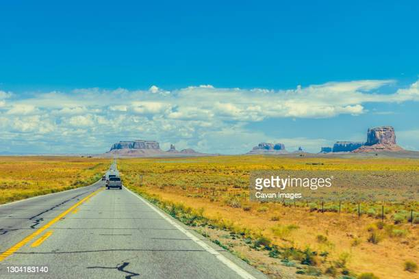 american southwest road during a road trip to famous national parks - valley of fire state park stock pictures, royalty-free photos & images