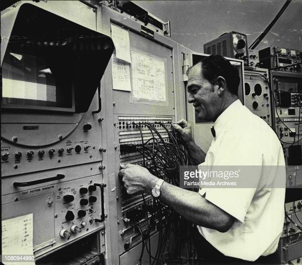 American Space Scientist Mr Robert Taylor Chief of the NASA observes at the grant 210ft radiotelescope at Parkes for the moon shot prepares the...