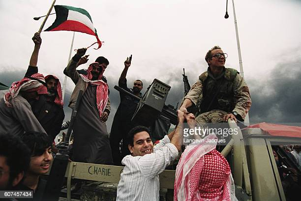 American Special Forces troops celebrate the liberation of Kuwait with Kuwaiti civilians in the streets