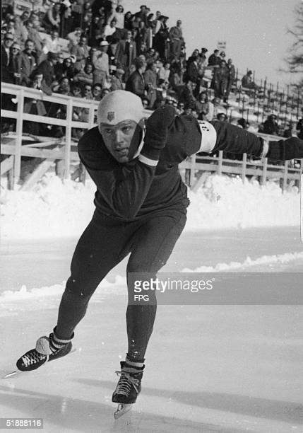 American speed skater Kenneth Bartholomew races down the track at the 1948 Winter Olympic Games, where he, US teammate Bobby Fitzgerald, and Thomas...